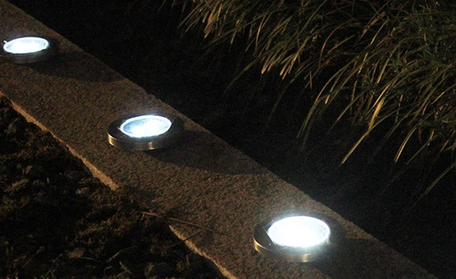 $29.95 for a Solar 8-LED Pathway Disk Lights - 4 Pack (a $109.99 Value)