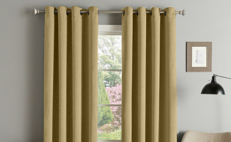 Click to view $16.96 for Kayla Grommet Blackout Curtains (a $62.99 Value)