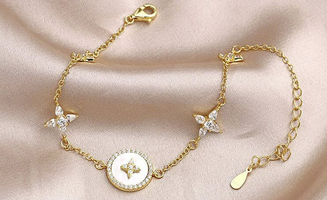 $21.90 for a White Nacre Circle Charm Bracelet (a $129 Value)