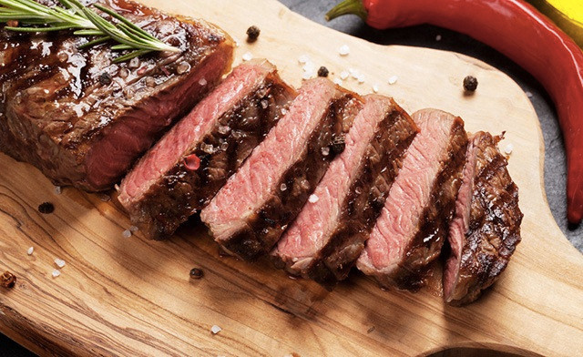 FREE HOME DELIVERY! $86 for 10 x 12 oz New York Hand-Cut AA/AAA Striploin Steaks (a $180 Value)
