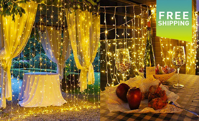 $26.95 for 300 LED Curtain String Lights in Warm White (a $75 Value)